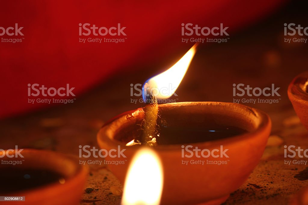 Beautifully oil lamps lit for the hindu diwali festival stock photo