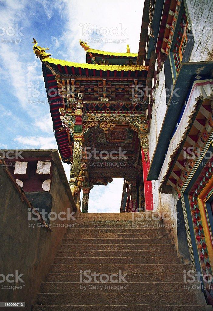 beautifully painted, ornamental gate to a tibetan monastery stock photo