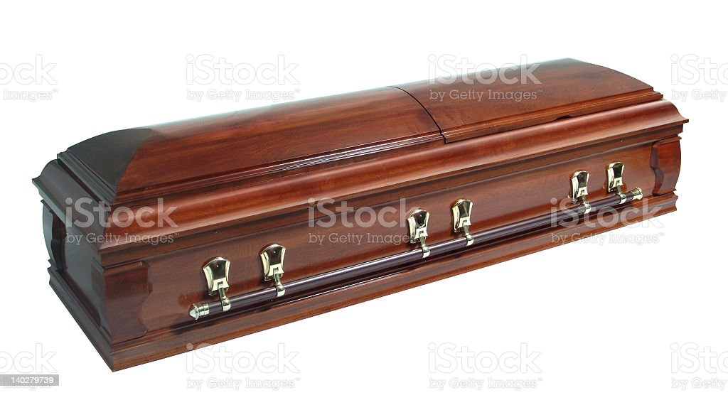 A beautifully polished wooden casket with deep timber tone  stock photo