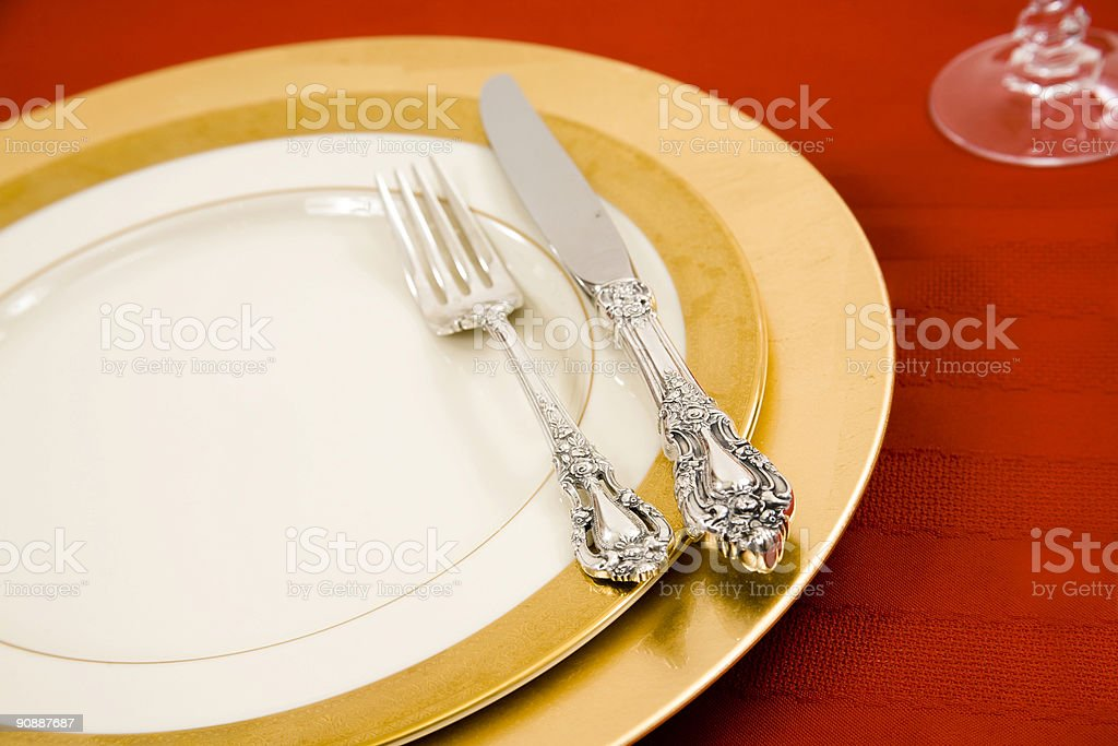 Beautifully set plate with gold charger royalty-free stock photo