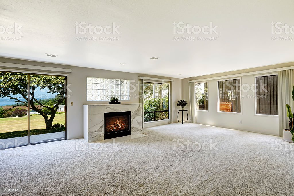 Beautitful living room with fireplace and walkout deck stock photo