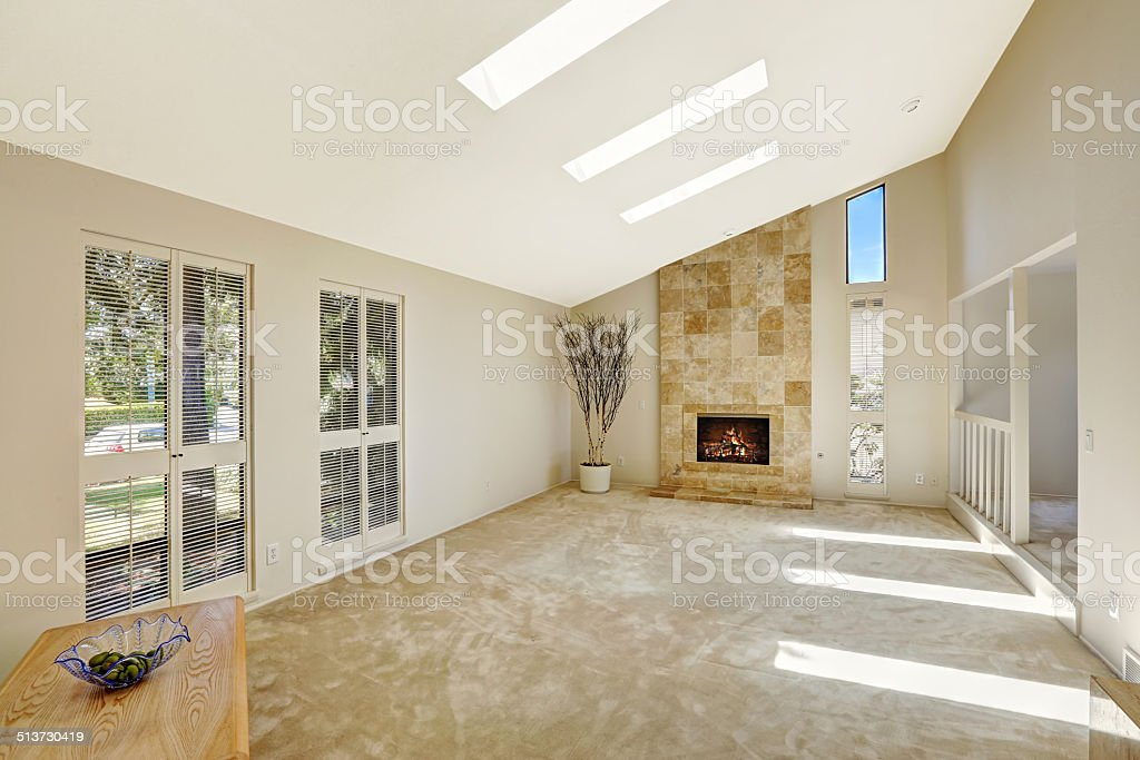 Beautitful living room with vaulted ceiling and skylights. Empty stock photo