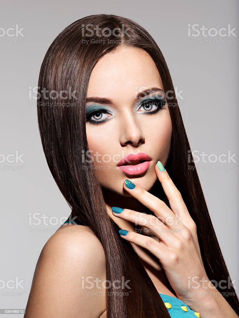 Beautiul elegant woman with turquoise make-up and nails. Straigh stock photo