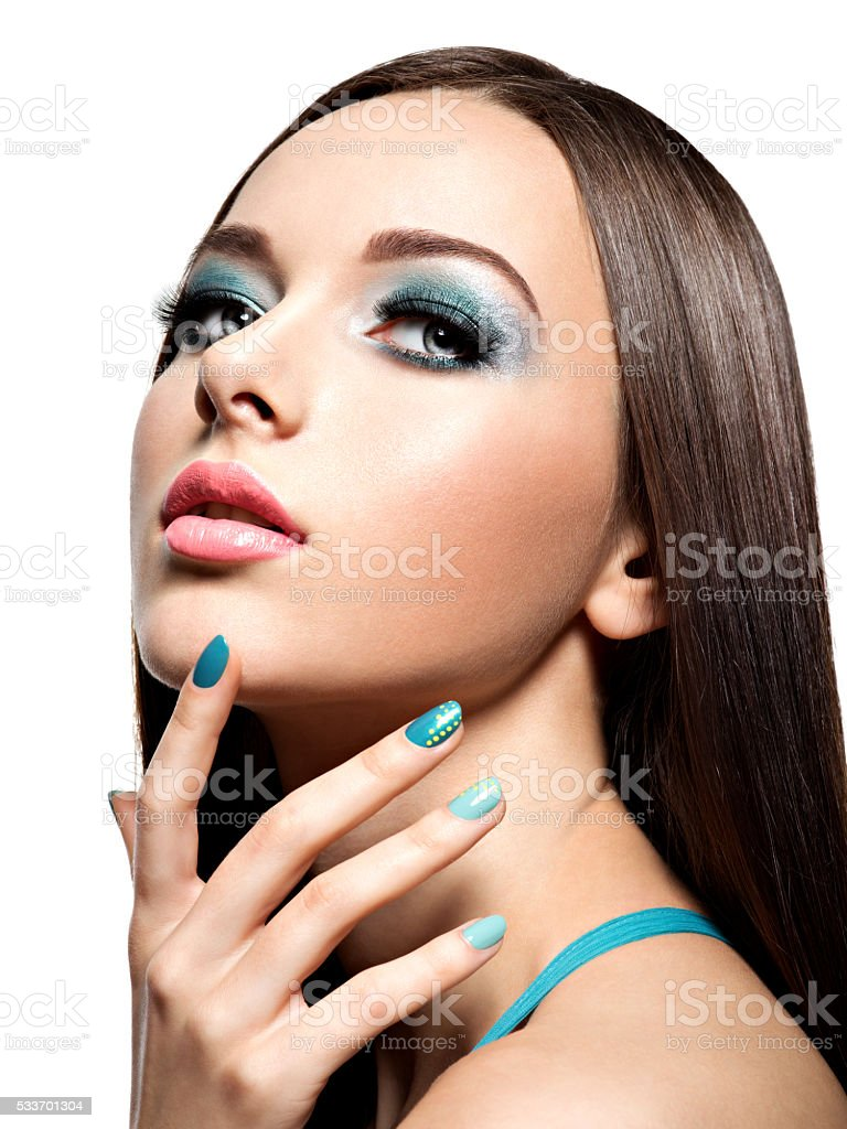 Beautiul fashion woman with turquoise make-up and nails stock photo