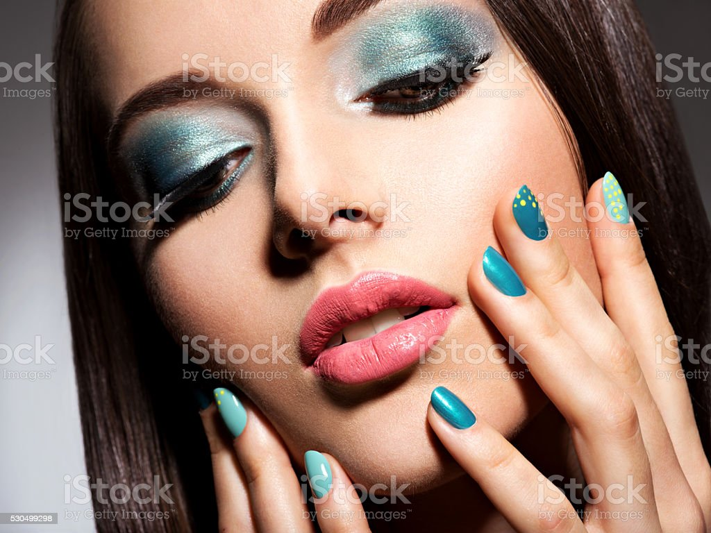 Beautiul fashion young adult girl with turquoise make-up and stock photo