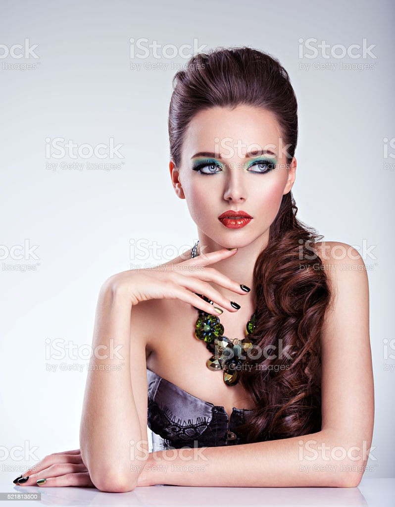 Beautiul woman with green make-up and creative color of stock photo