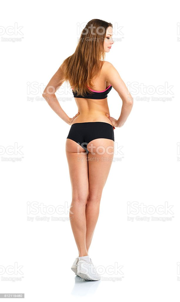 Beauty athletic girl on white, view from the back stock photo