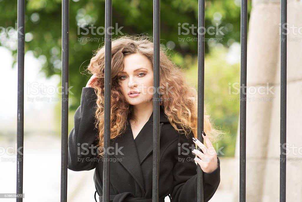 Beauty behind bars, a man-eater stock photo