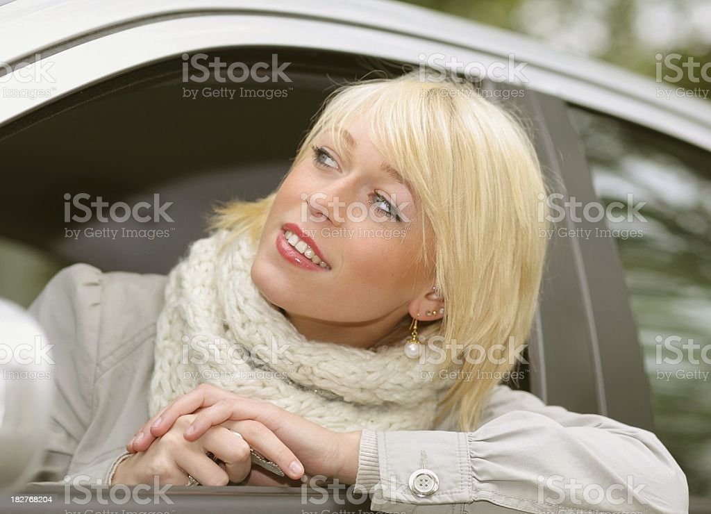 beauty blond teenager is looking out her car royalty-free stock photo