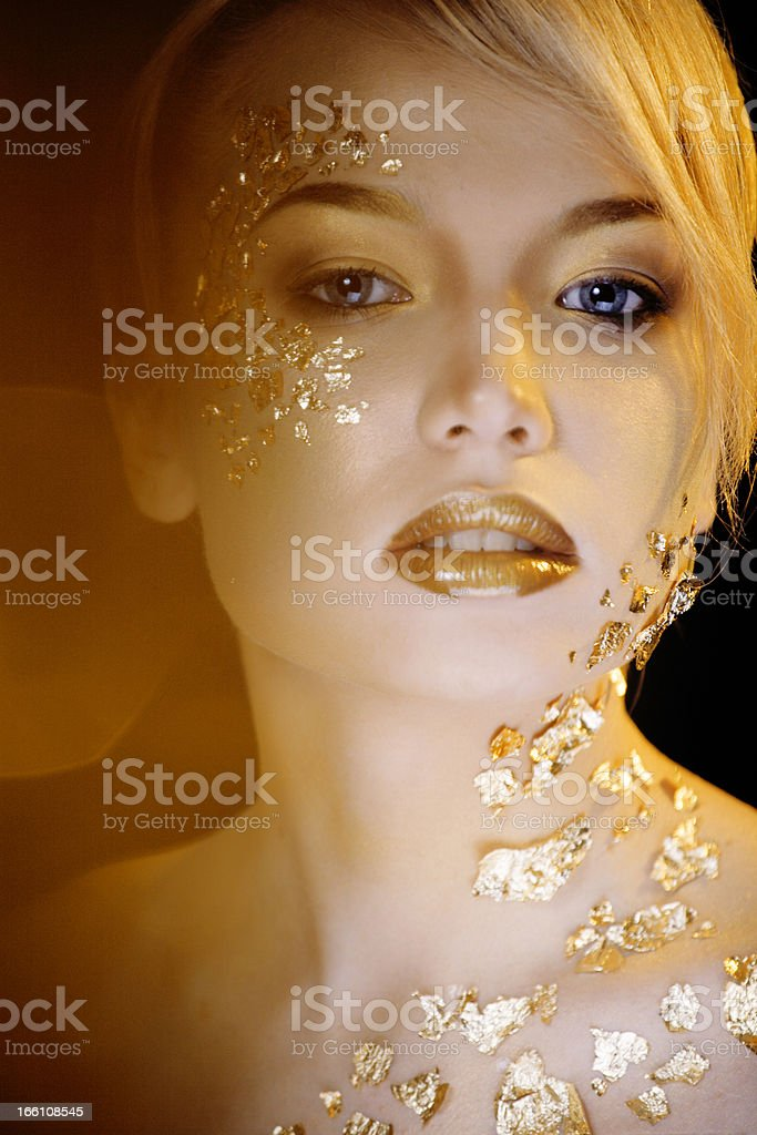 beauty blond woman with gold creative make up royalty-free stock photo
