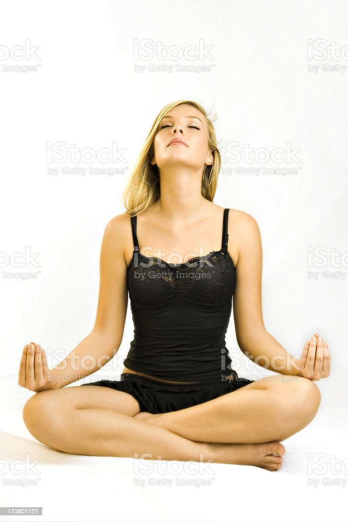 Beauty blonde girl practicing meditation royalty-free stock photo