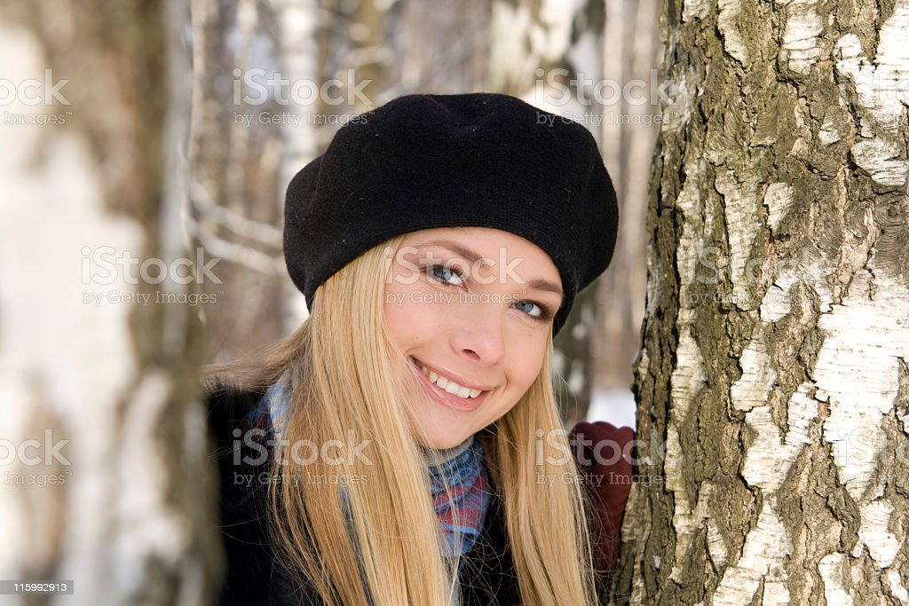 Beauty blonde with trees royalty-free stock photo