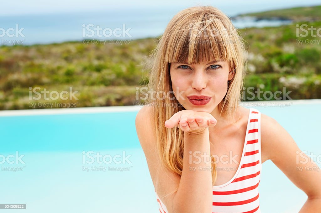 Beauty blowing a kiss stock photo
