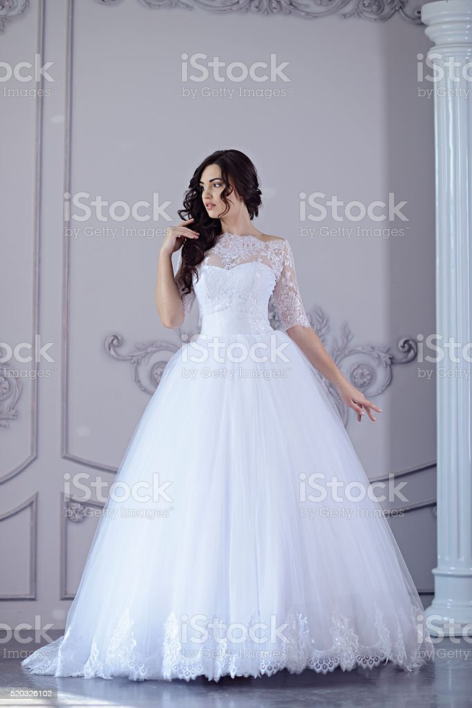 Beauty bride in bridal gown indoors stock photo