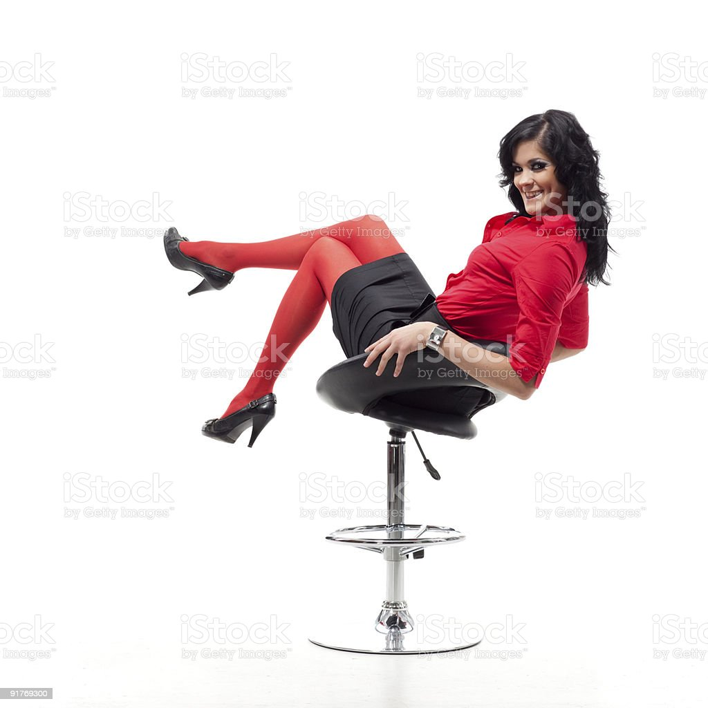 Beauty brunette poses on chair. royalty-free stock photo