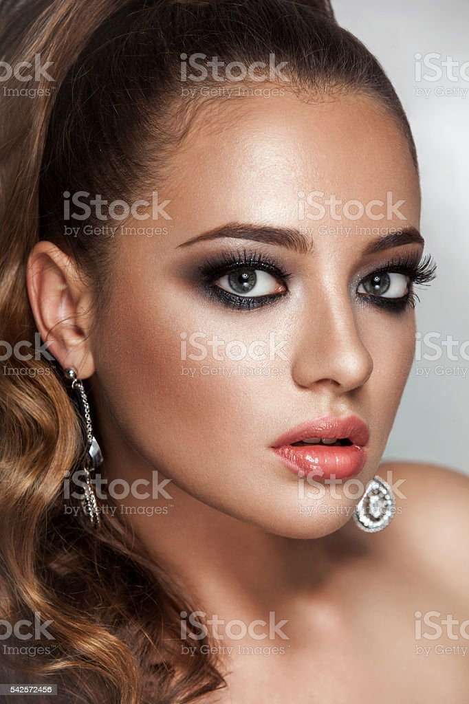 Beauty brunette woman with long healthy curly brown hair ponytail stock photo