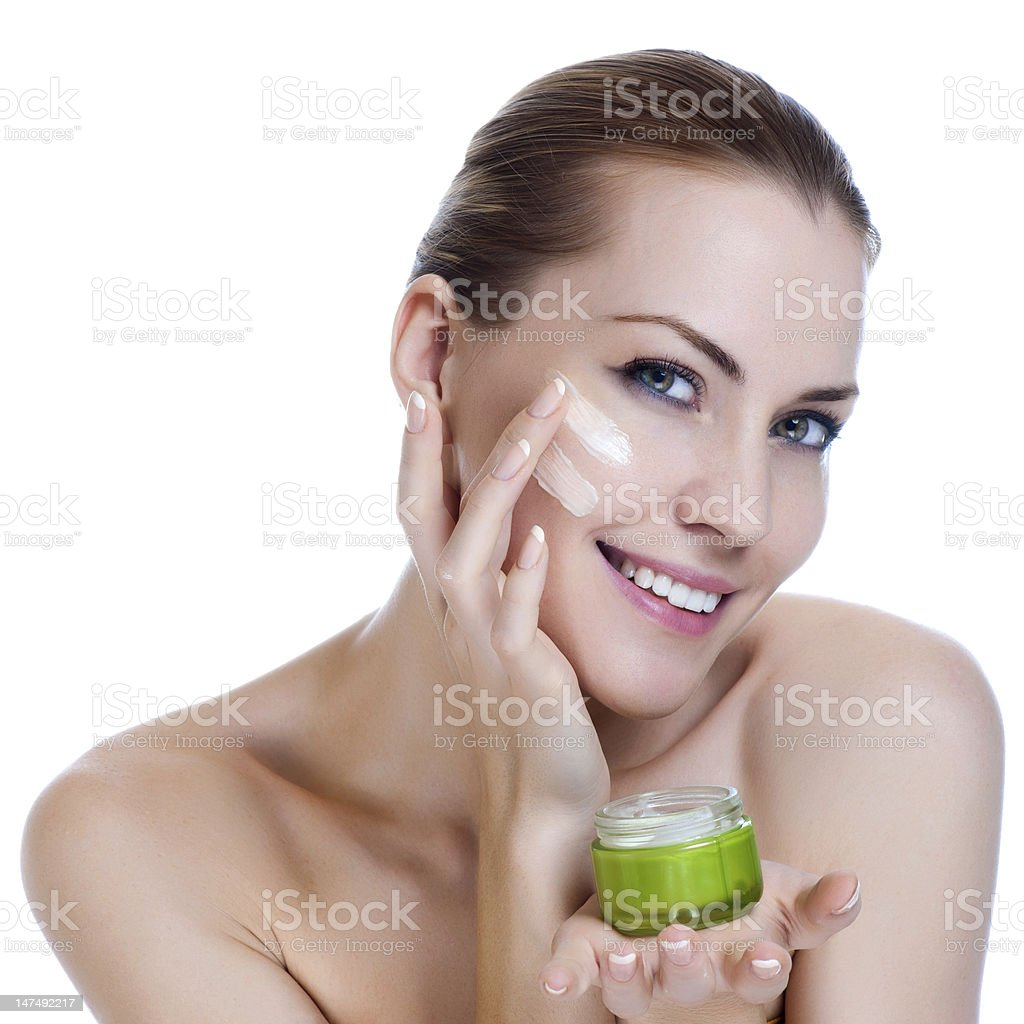 Beauty caucasian young woman applying cosmetic under eyes royalty-free stock photo