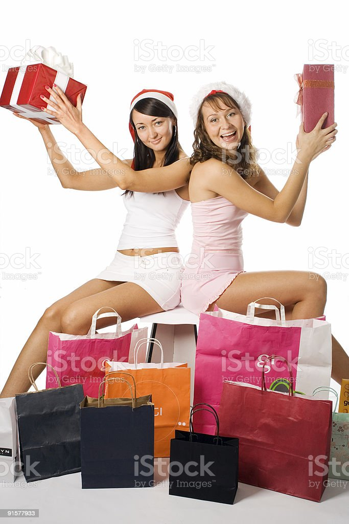 beauty christmas girls in red hat with box gift royalty-free stock photo