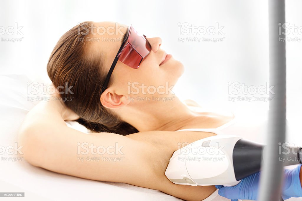 Beauty clinic, laser hair removal. stock photo
