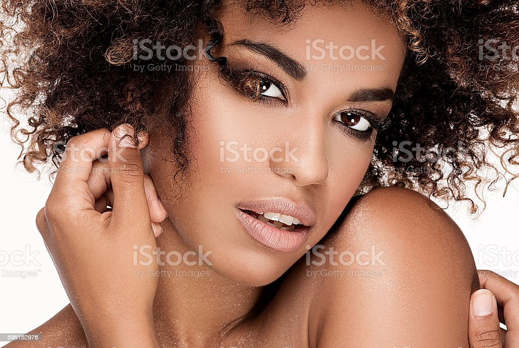Beauty closeup portrait of girl with afro. stock photo