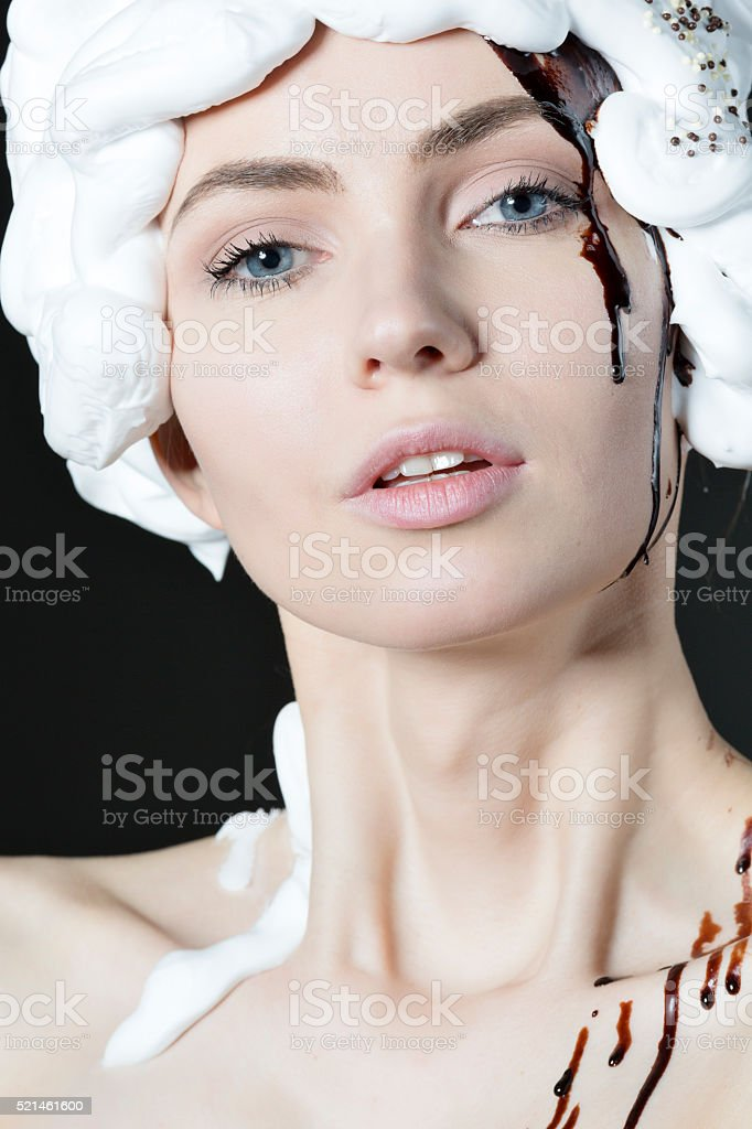 Beauty face with chocolate and white cream stock photo