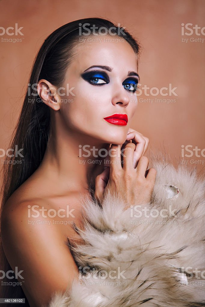 Beauty Fashion Model Girl in a fur coat and lingerie. stock photo