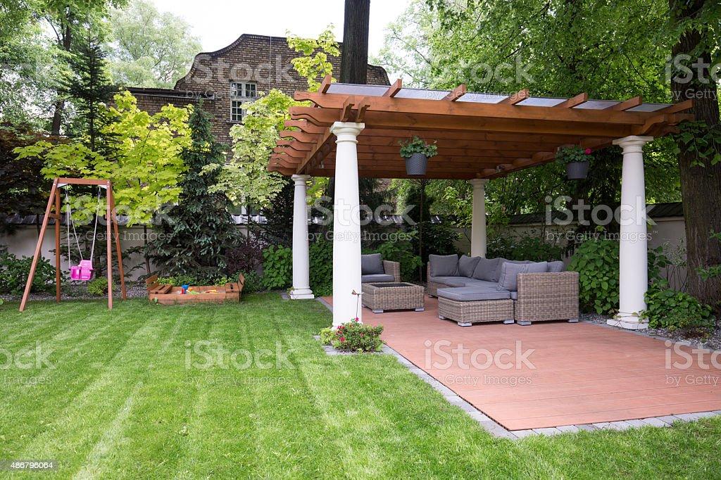 Beauty garden with modern gazebo stock photo