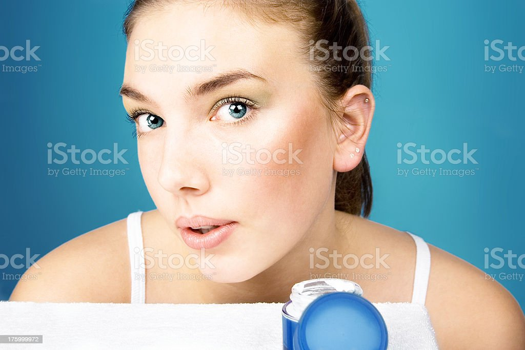 Beauty girl and face cream 2 stock photo