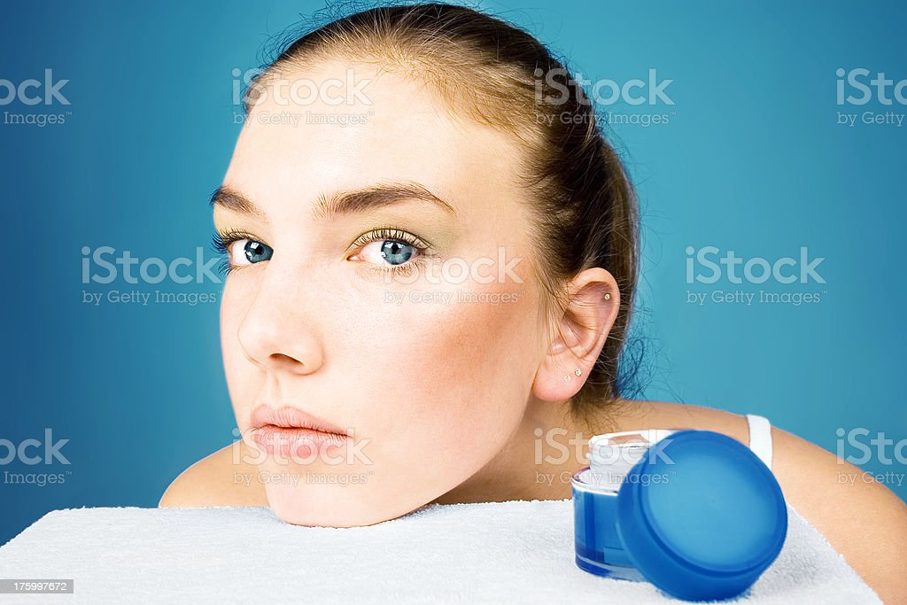 Beauty girl and face cream royalty-free stock photo