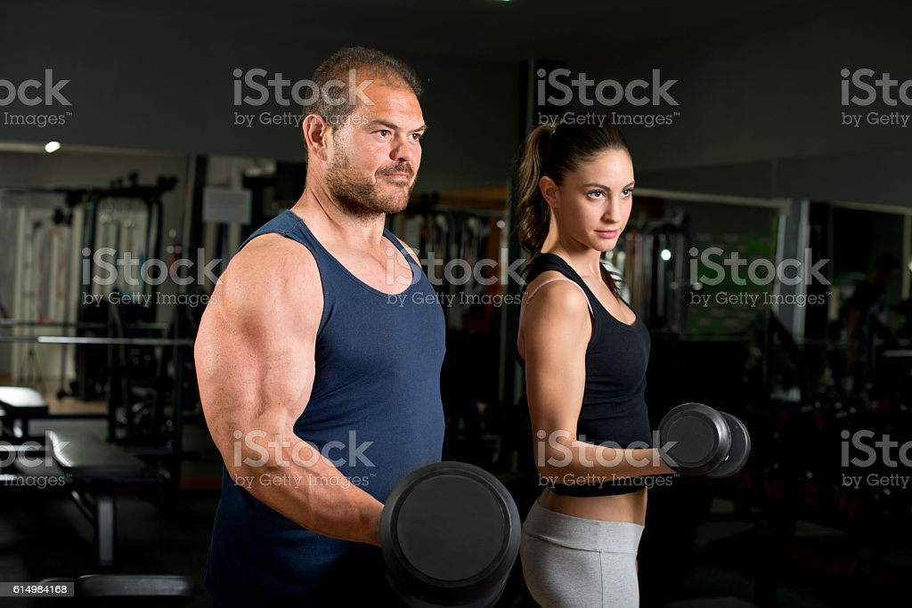 Beauty girl and strong coach stock photo