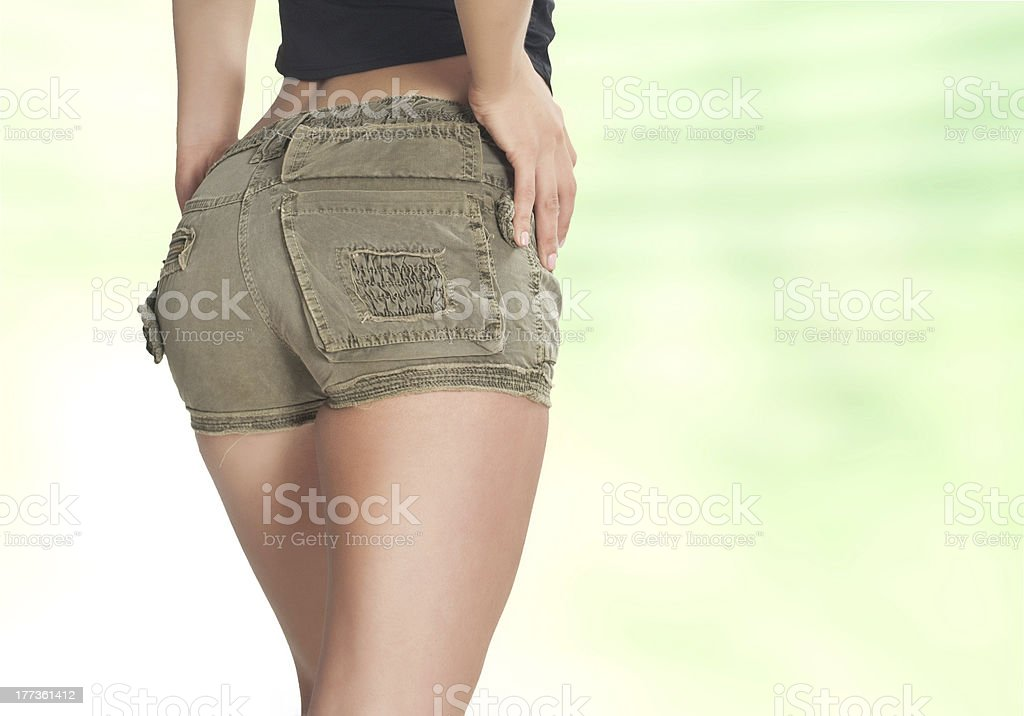Beauty girl back in green pants royalty-free stock photo