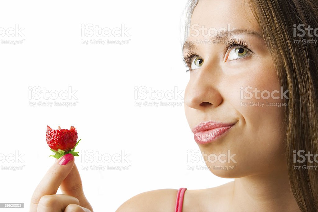 beauty girl close-up portrait bite strawberry royalty-free stock photo