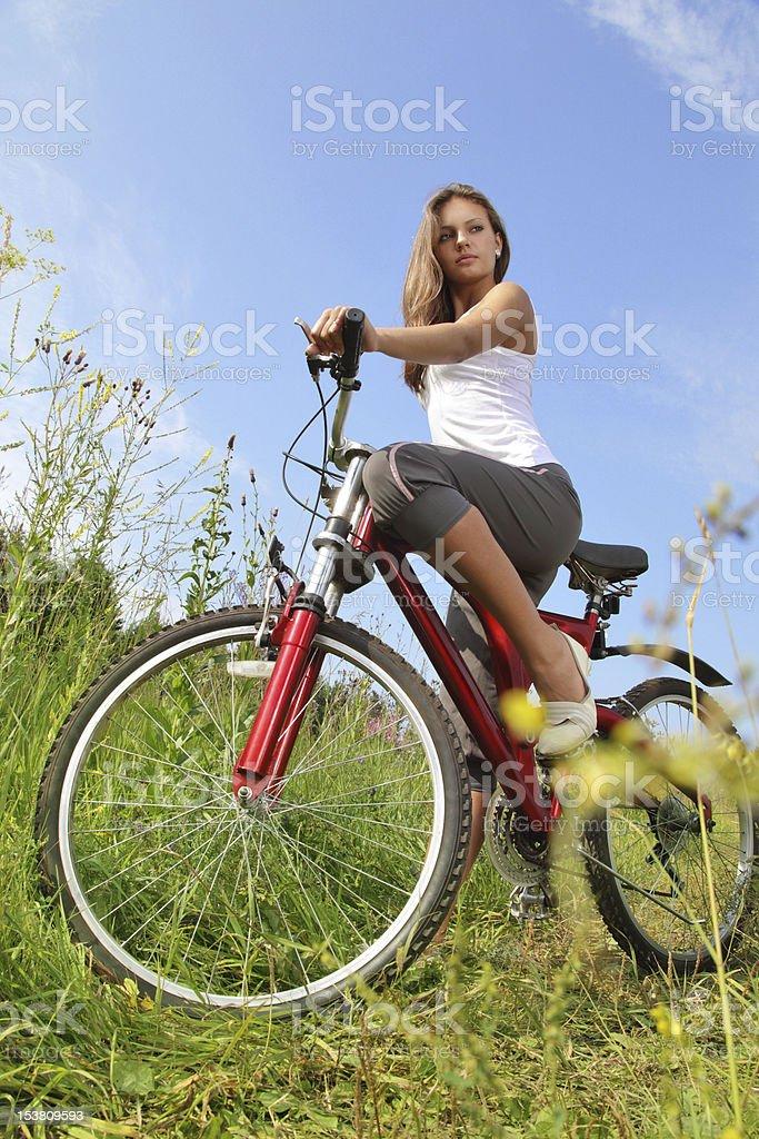 Beauty girl on bike outdoor royalty-free stock photo