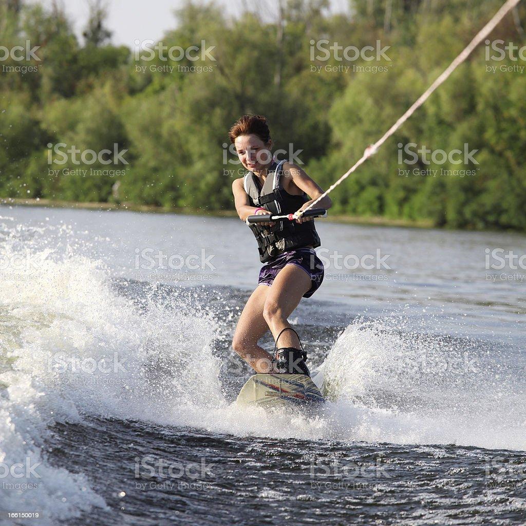 beauty girl on wakeboard stock photo