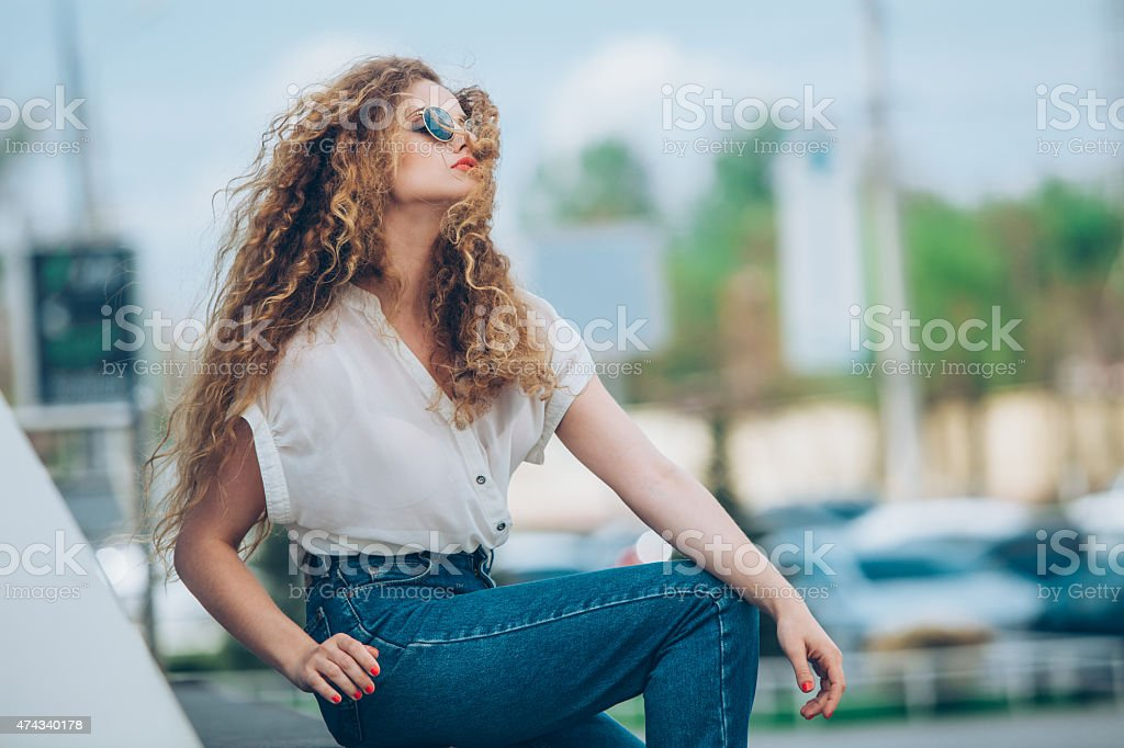 Beauty Girl Outdoors enjoying nature. Beautiful Teenage Model girl with stock photo