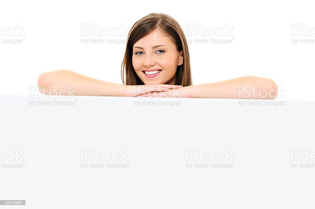Beauty happy female face with empty billboard royalty-free stock photo