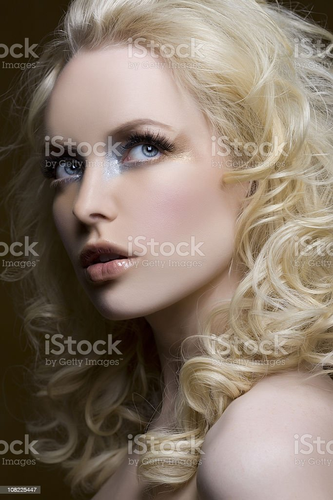 Beauty Head Shot of Young Woman with Curly Blond Hair royalty-free stock photo
