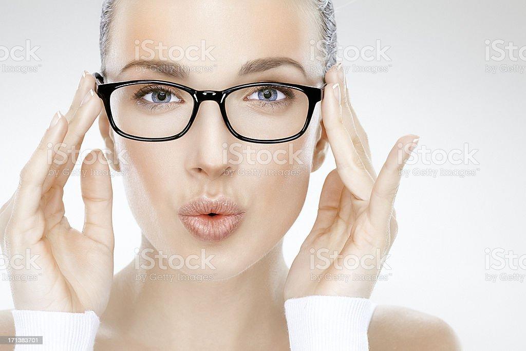 Beauty headshot of beautiful woman holding eyeglasses and blowing kisses stock photo