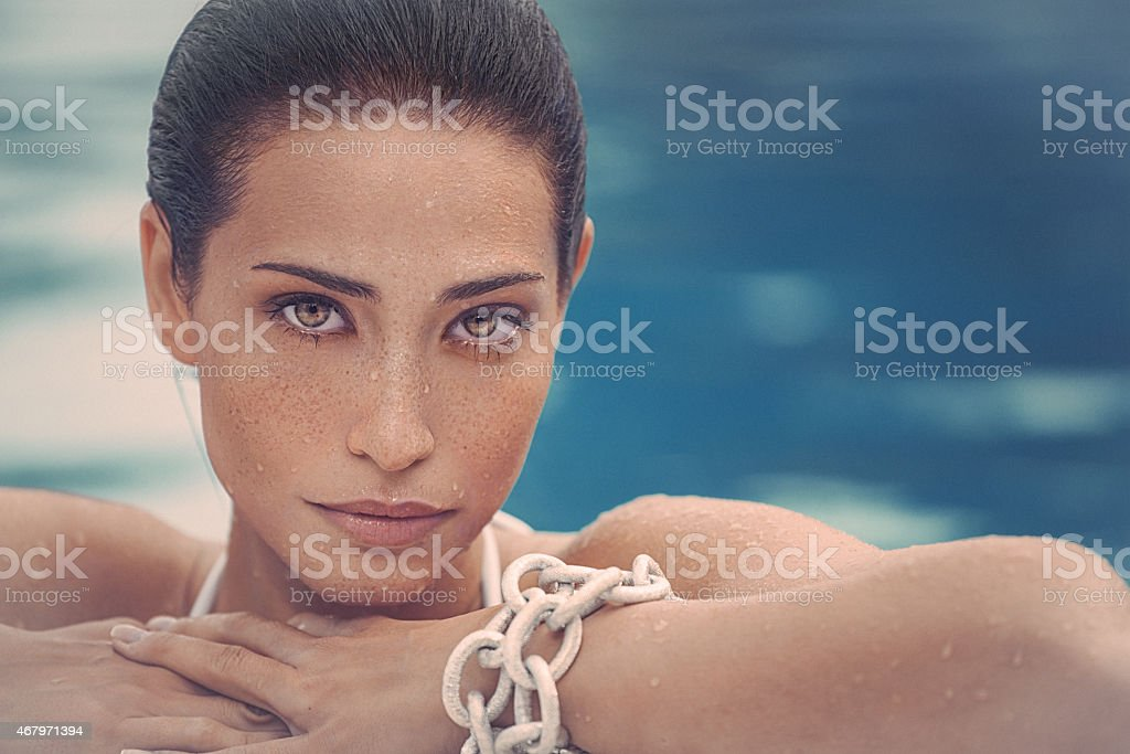 Beauty headshot of young woman with freckless on her face stock photo