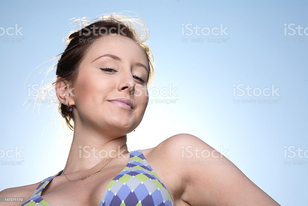 Beauty in bathing suit with sky background. stock photo