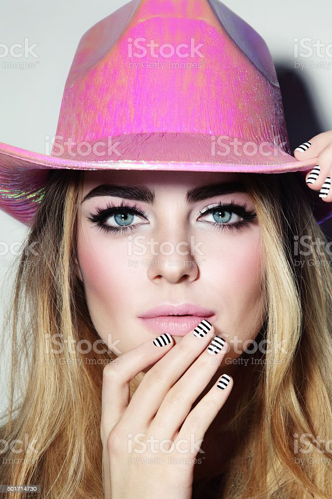 Beauty in cowboy hat stock photo