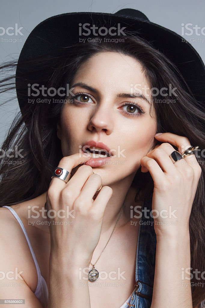 Beauty in jeans with hat stock photo