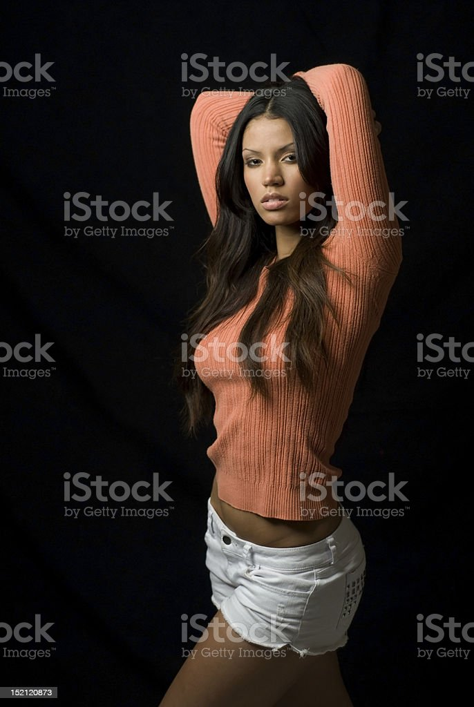 Beauty in orange sweater stock photo