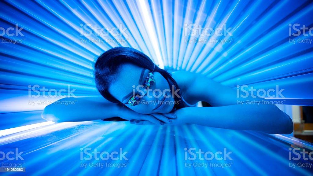 Beauty in solarium. stock photo