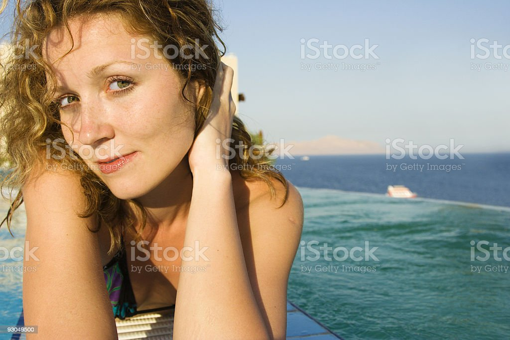 Beauty laying on edge of infinity pool royalty-free stock photo