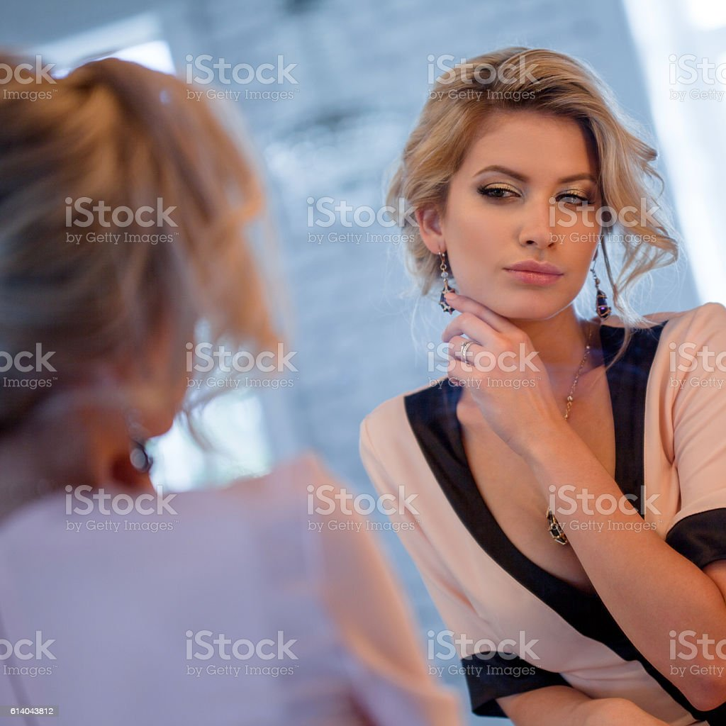 Beauty luxury blonde woman. Attractive young model in beautiful dress stock photo