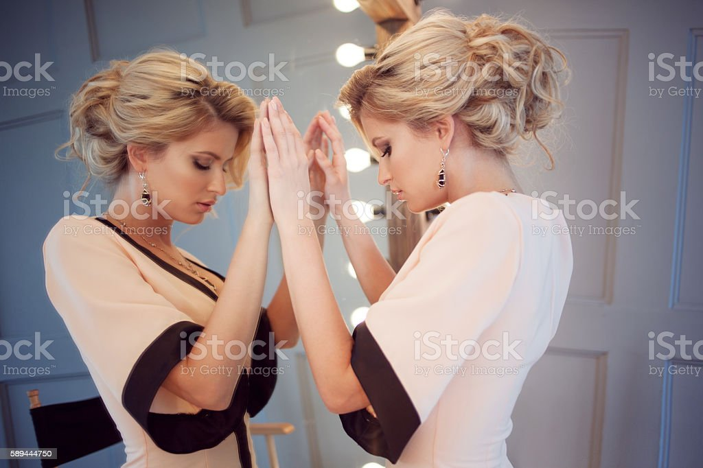 Beauty luxury blonde woman with and mirror, close-up stock photo