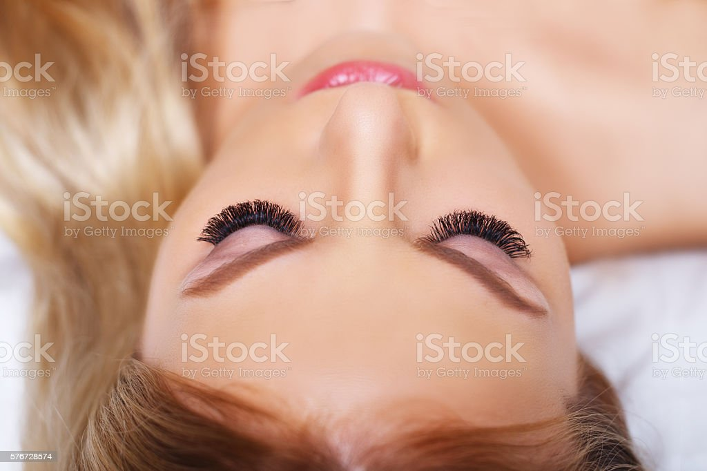 Beauty makeup for blue eyes. Part of beautiful face closeup. stock photo