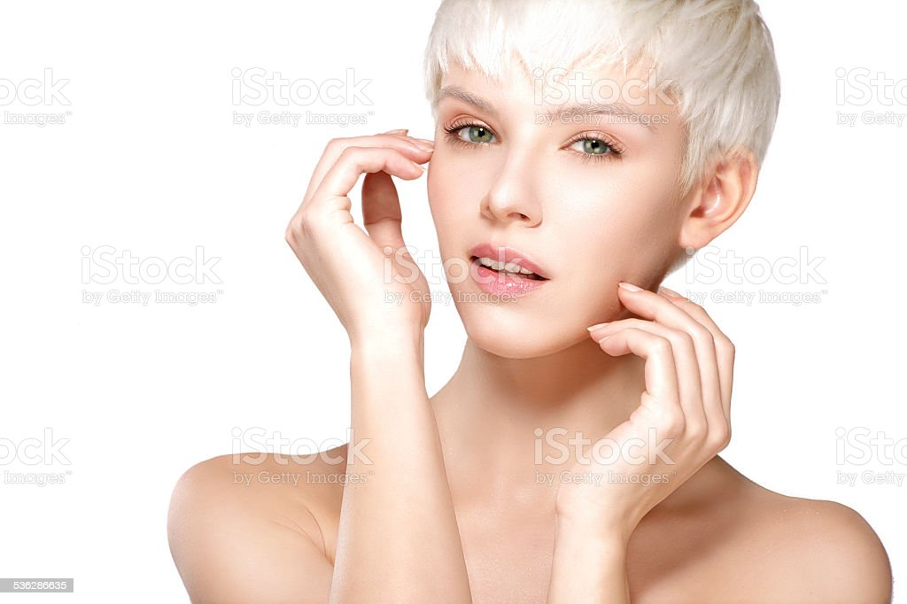 Beauty model blonde short hair showing perfect skin stock photo