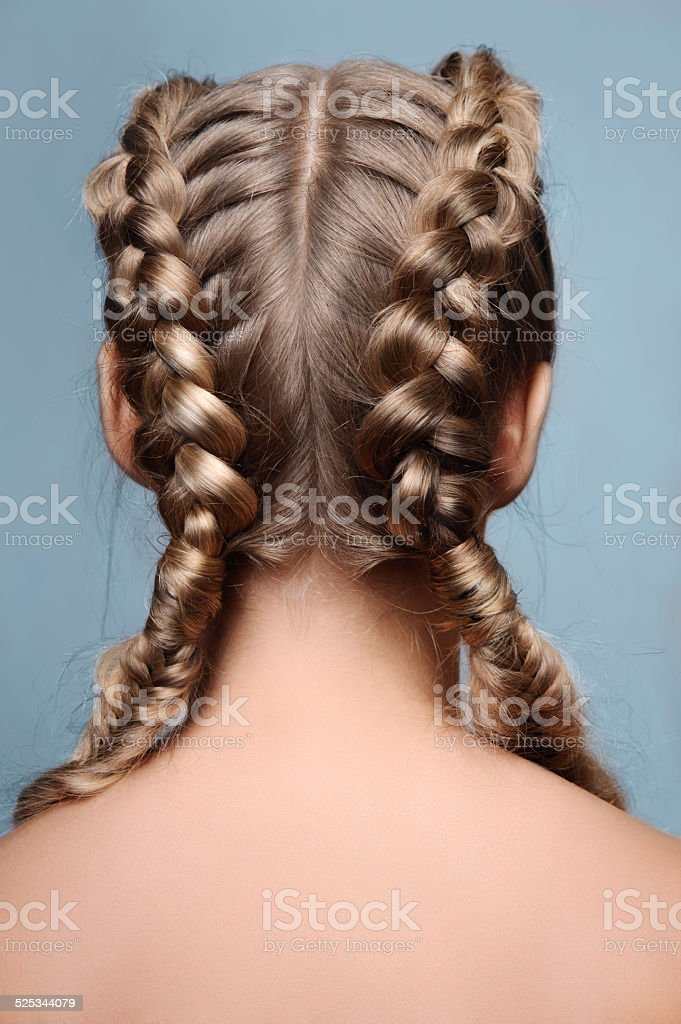 Beauty model with braids from back stock photo